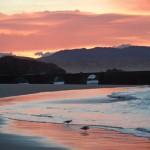 'Amanecer en la Magdalena'. Fue realizada el 31 de diciembre sobre las 8 de la mañana y se puede apreciar un cielo de color rosa reflejado sobre el mar. Autora: Miriam Alonso
