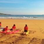 Surf sobre la arena del Sardinero