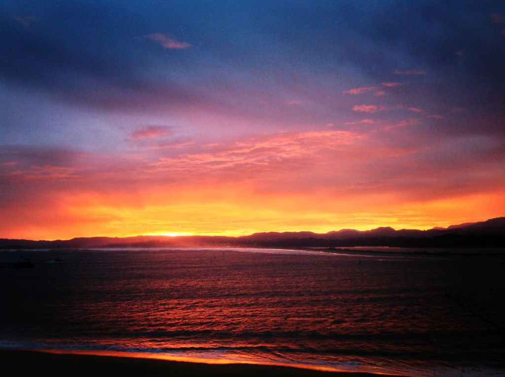 amanecer-playa-magdalena-santander-rojos