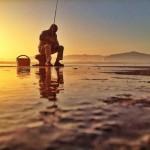 Pescar en el muelle Calderon. Sobre el noray