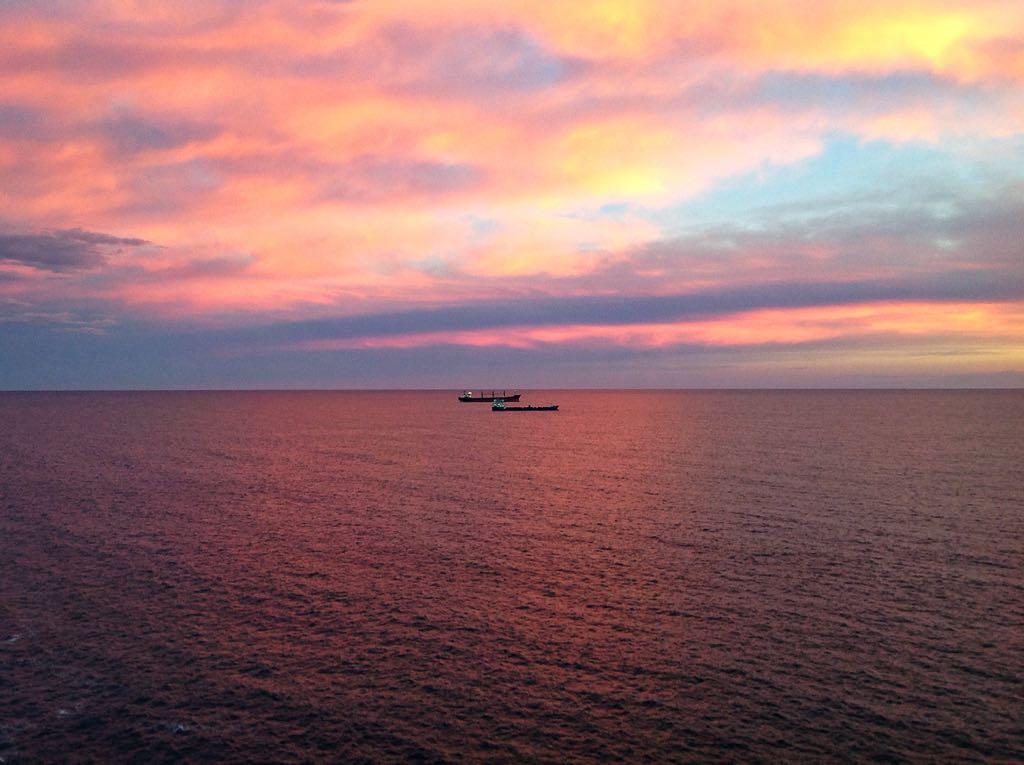 amanecer-abra-sardinero-barcos-naranja