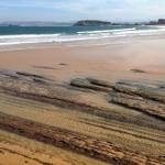 Las lastras del Chiqui, al descubierto. Arena que se lleva la mar