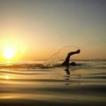 Nadar a la salida del sol. En el Sardinero