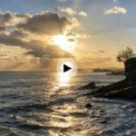 Martes. Un amanecer soleado y con nubes en el horizonte